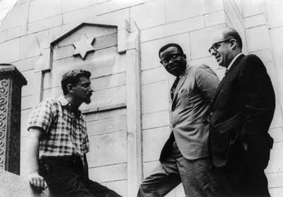 Lew Kreinberg (from left), Rev. Shelvin Hall and Rabbi Robert Marx meet in front of the Friendship Baptist Church, formerly a Jewish synagogue (c. 1967).